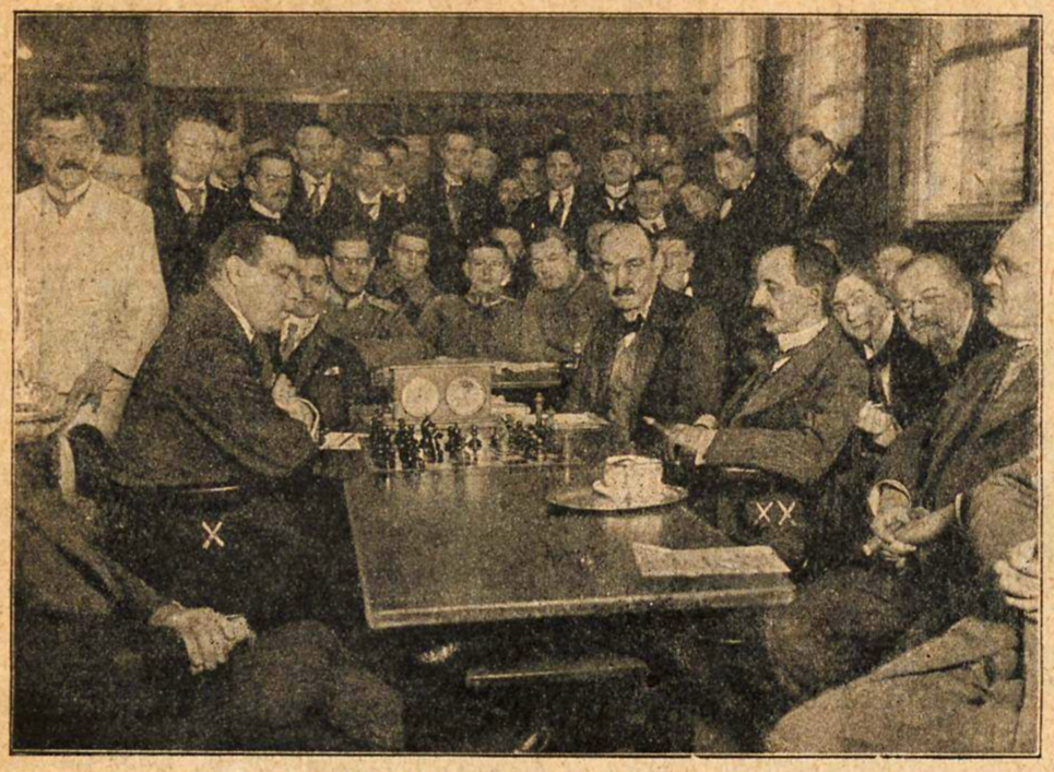 The only known photo from the match. Rubinstein is seated on the left, and Schlechter on the right.